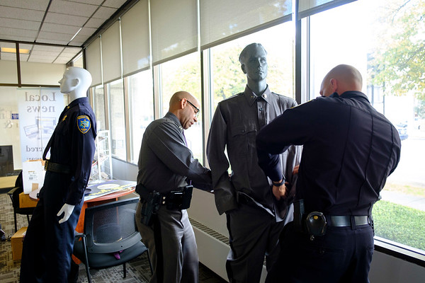 Joed Viera/Staff Photographer-NY State Police Zone  Commander Eric Laughton and Niagara County Sheriff's Lt. Robert Richards dress up dummys in law enforcement  uniforms at the US&J offices for Lockport Blue.