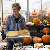 Joed Viera/Staff Photographer-Vicki Harris holds two freshly baked pies ar Harris Farms.