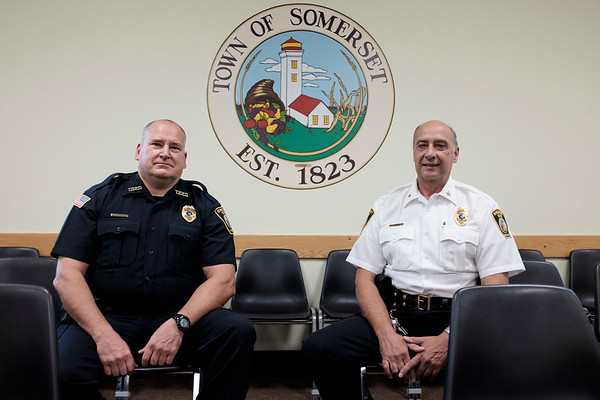 Joed Viera/Staff Photographer-Somerset's incoming Town Police chief Jon Miller sits with outgoing chief John Yotter at Somerset Town Hall.
