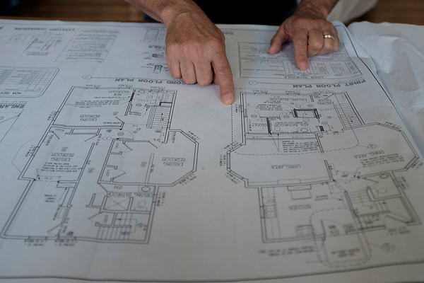 Joed Viera/Staff Photographer-Toby Mansfield goes over plans for Lockport Cares' Kahler House renovations.