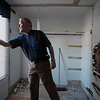 Joed Viera/Staff Photographer-Reverend Alan Bauch opens a blind in a second floor, yet to be renovated room at Lockport Cares' Kahler House .