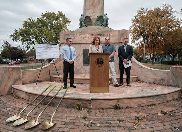 Joed Viera/Staff Photographer-Common Council Chairman David R. Wohleben, 5th Ward Alderman Rick Abbott and Senator Robert Ortt look on as Lockport Mayor Anne McCaffrey announces the restoration of the monument at Veterans Memorial Park.