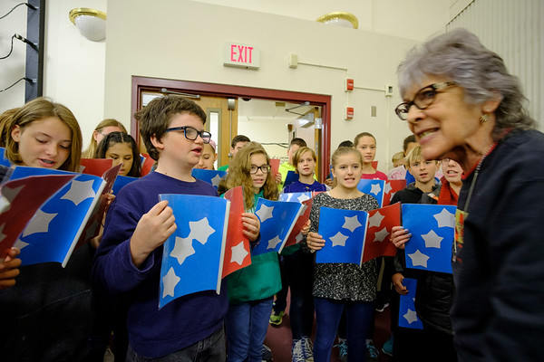 "Joed Viera/Staff Photographer-Renee Knight, right, helps North Park Jr. High School students rehearse R.W. Lillard's ""America's Answer."" The students will read the poem for the annual Veterans Day program at Outwater Park."