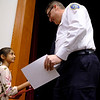Joed Viera/Staff Photographer-Fricano 1st-grader and shining star student Suhana Kanwal hands Niagara County Sheriff James Voutour a hand written thank you card on behalf of the primary school.