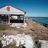 Joed Viera/Staff Photographer- Excavators have started to restore the broken break walls surrounding the Olcott Yacht Club.