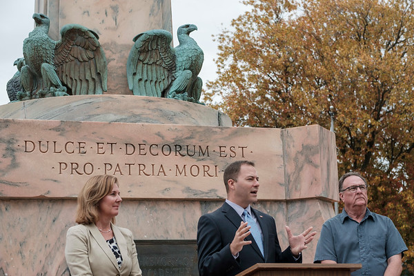 Joed Viera/Staff Photographer-Lockport Mayor Anne McCaffrey and Ward Alderman Rick Abbott look on as Senator Robert Ortt speaks at an announcement for the restoration of the monument at Veterans Memorial Park.