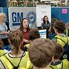 Joed Viera/Staff Photographer-Students from local High Schools watch a presentation on detecting oroduct imperfections at GM's Lockport component holdings plant during a Manufacturing Week event.