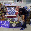 Joed Viera/Staff Photographer-Charlie Baker stocks Ace Hardware's  shelves with Lockport Blue merchandise.