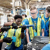 Joed Viera/Staff Photographer-Lockport High School Students assemble a corvette engine at GM's Lockport component holdings plant during a Manufacturing Week event.