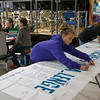 Joed Viera/Staff Photographer-Royalton 7th-graders Ada Noble, 12 and Grace Trombley, 12, sign a banner for Rachel's Challenge.