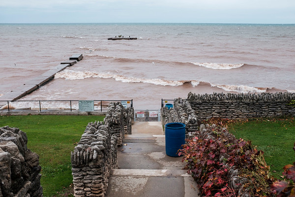Joed Viera/Staff Photographer- Wednesday's winds helped form waves along the Lake Ontario shoreline at Olcott Beach.