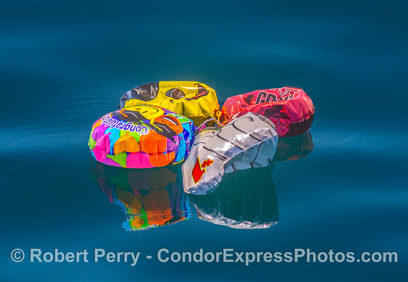 Mylar plastic death balls floating on the open ocean.