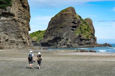 Piha Bay, NZ.  Phil and Lora Chow on a beach walk