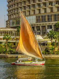 DA040,DT,GoldenSailsReflectOnTheNileRiverCairoEgypt-081