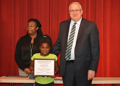 Chequetta Holmes accepts a 2017 STAND Award from DCSD Superintendent Dr. Eddie Ingram.
