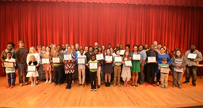 Parents joins their students on stage following the Darlington County School District's 2017 STAND Awards ceremony.