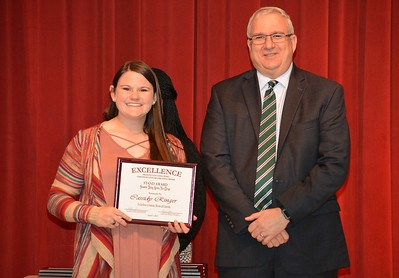 Cassidy Ringer accepts a 2017 STAND Award from DCSD Superintendent Dr. Eddie Ingram.
