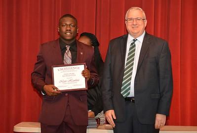 Nasir Hawkins accepts a 2017 STAND Award from DCSD Superintendent Dr. Eddie Ingram.