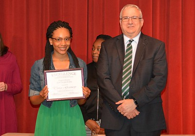Tyra Gainey accepts a 2017 STAND Award from DCSD Superintendent Dr. Eddie Ingram.