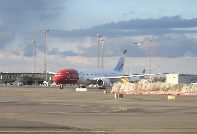 A Norwegian Long Haul Boeing 787 Dreamliner on the stands at Copenhagen Airport.