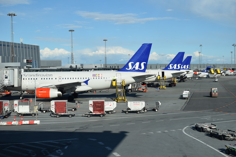 Scandinavian Airlines aircraft at Copenhagen airport, with Airbus A319 OY-KBP closest.