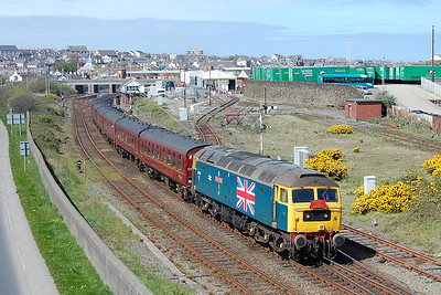 During the hour layover in the town the tour was booked to shunt to/from the Washer Road. Rather than stay on the train, I opted for the photographic opportunity: 47580 is seen here climbing past the site of Holyhead MPD before setting back down the hill into the station yard (22/04/2017)