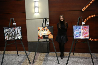"Casey Haas with her artwork, ""Kate Moss"", ""Fame"", ""Perfume""."