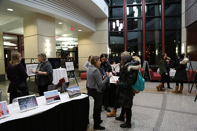 Guests enjoying the 3rd Annual ART of the Wisconsin BBA Exhibition.