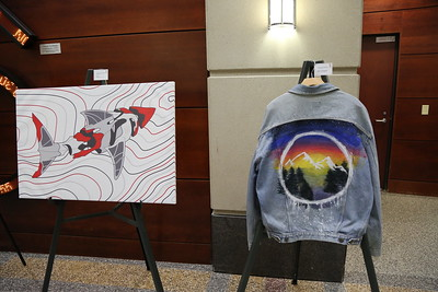 "(From Left to Right) ""Shark"" by Nathan Mueller, Back to Backwoods (Denim Jacket) by Jessica Rollins"