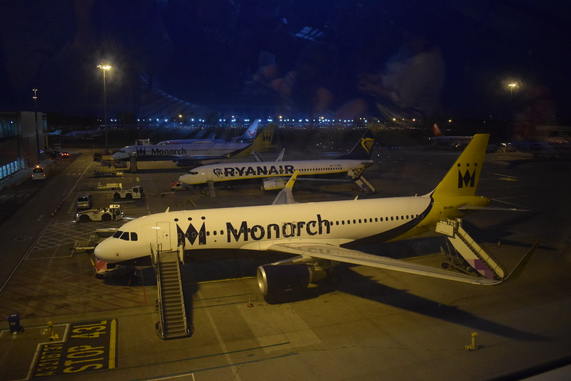 A line-up of aircraft at London Luton, including Monarch Airbus A320 G-ZBAS, Ryanair Boeing 737-800 EI-DWT and Monarch Airbus A321 G-OZBM.