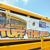 MET 080217 Stuff the bus banner