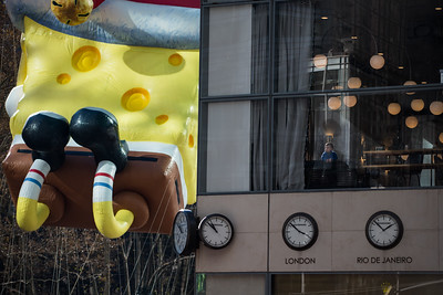 How the 1% watch the parade.  Little boy and Sponge Bob.