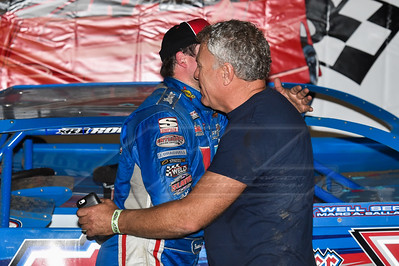 Mark Richards (R) congratulates driver Brandon Sheppard (L) in victory lane