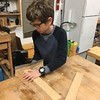 HAND-SANDING SOME OF THE PIECES FOR HIS SHELF