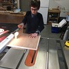 ALEX USES THE TABLE SAW TO CUT WOOD FOR HIS BED-SHELF