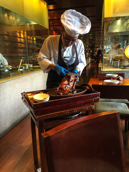 Carving the Peking Duck at Made In China in the Grand Hyatt