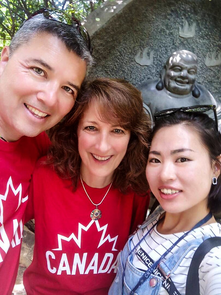 Two typical Canadians, a guide, and Buddha.