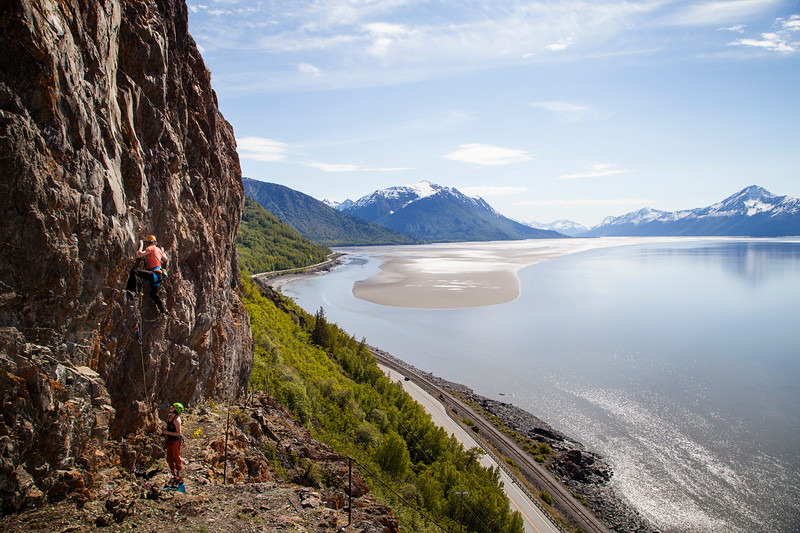 Ty pulling down on <i>Dino Later 5.11b</i> at Dino Head on the Seward Highway.