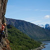 Ty works his way up <i>Dino's Stubble Trouble 5.10c/d</i> with the Turnagain Arm below.