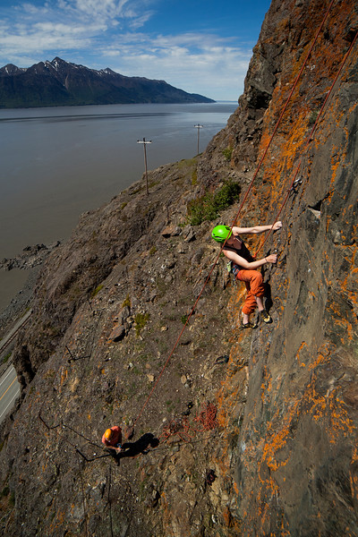 The Turnagain Arm provides the backdrop as Hailey works her way up <i>Pocket Rocket 5.10b</i> at Dino Head.
