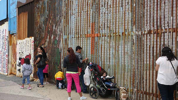 Israel and his family on the Mexican side of the U.S.-Mexico border - Playas de Tijuana
