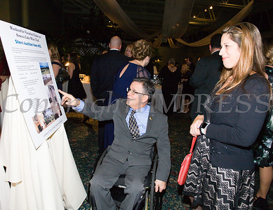 Doug Hovey, Executive Director of Independent Living looks at a silent auction item during Access: Supports For Living 2017 Gala on Saturday, November 18 at Anthony's Pier 9 in New Windsor, NY. Hudson Valley Press/CHUCK STEWART, JR.