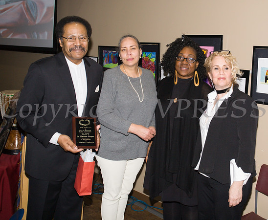Dr. Clarence Cooper receives his award from Ramona Burton, Malinda Ware and Rosina Tezgeldi during the City of Newburgh Human Rights Commission sponsored Second Annual Black Pioneers of Newburgh at the Newburgh Free Library on Saturday, February 18, 2017. Hudson Valley Press/CHUCK STEWART, JR.