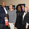 Kevin White receives his award from Ramona Burton, Malinda Ware and Rosina Tezgeldi during the City of Newburgh Human Rights Commission sponsored Second Annual Black Pioneers of Newburgh at the Newburgh Free Library on Saturday, February 18, 2017. Hudson Valley Press/CHUCK STEWART, JR.