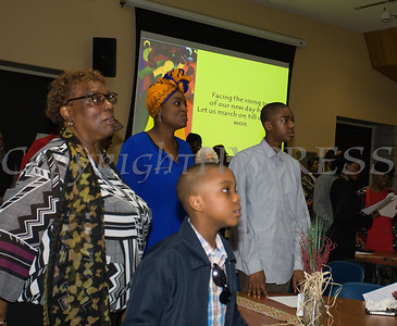 The audience sings the Black National Anthem during the City of Newburgh Human Rights Commission sponsored Second Annual Black Pioneers of Newburgh at the Newburgh Free Library on Saturday, February 18, 2017. Hudson Valley Press/CHUCK STEWART, JR.