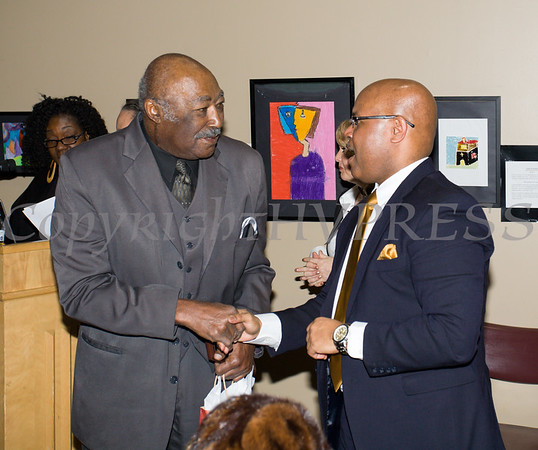 honoree Robert Moody is congratulated by Phillip Howard during the City of Newburgh Human Rights Commission sponsored Second Annual Black Pioneers of Newburgh at the Newburgh Free Library on Saturday, February 18, 2017. Hudson Valley Press/CHUCK STEWART, JR.