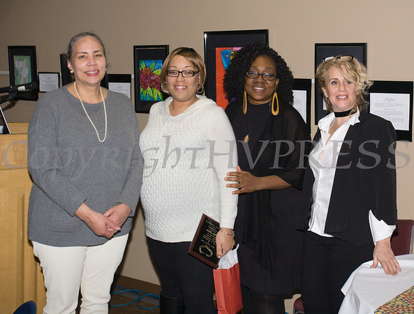 Faika Wilson, second from left, accepts the award for her grandmother Sadie Tallie, from Ramona Burton, Malinda Ware and Rosina Tezgeldi during the City of Newburgh Human Rights Commission sponsored Second Annual Black Pioneers of Newburgh at the Newburgh Free Library on Saturday, February 18, 2017. Hudson Valley Press/CHUCK STEWART, JR.
