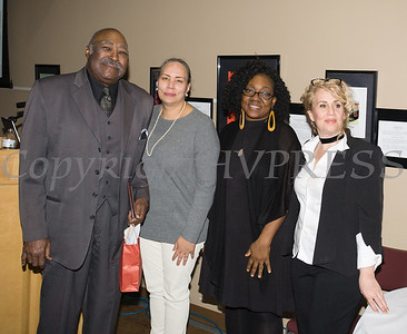Robert Moody receives his award from Ramona Burton, Malinda Ware and Rosina Tezgeldi during the City of Newburgh Human Rights Commission sponsored Second Annual Black Pioneers of Newburgh at the Newburgh Free Library on Saturday, February 18, 2017. Hudson Valley Press/CHUCK STEWART, JR.