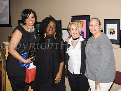 Arreda Cotton receives her award from Malinda Ware, Rosina Tezgeldi and Ramona Burton during the City of Newburgh Human Rights Commission sponsored Second Annual Black Pioneers of Newburgh at the Newburgh Free Library on Saturday, February 18, 2017. Hudson Valley Press/CHUCK STEWART, JR.