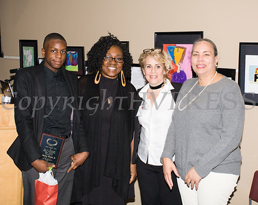 Anthony Grice, Jr. receives his award from Malinda Ware, Rosina Tezgeldi and Ramona Burton during the City of Newburgh Human Rights Commission sponsored Second Annual Black Pioneers of Newburgh at the Newburgh Free Library on Saturday, February 18, 2017. Hudson Valley Press/CHUCK STEWART, JR.